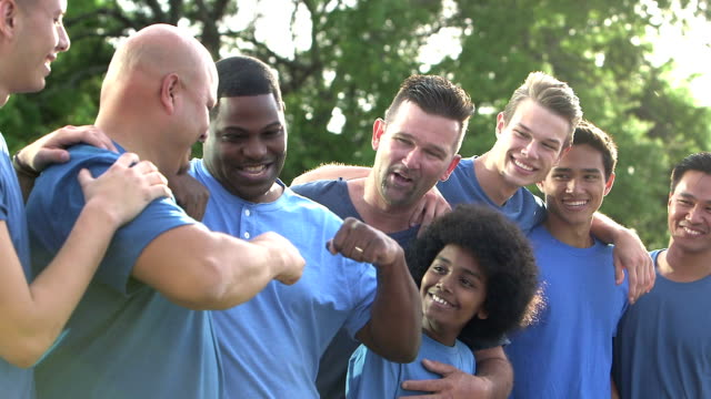 Multi-ethnic fathers and sons in blue, fist bump video