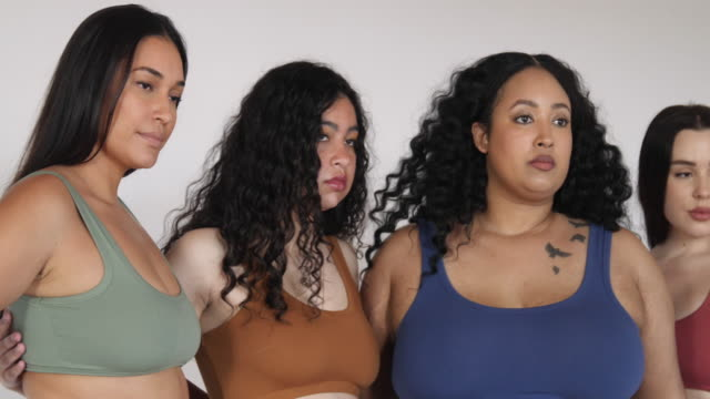 Multi-ethnic female plus size models in lingerie Group of women with different body type in underwear standing together on white background. Curvy female models in lingerie. Body positive concept. plus size model stock videos & royalty-free footage