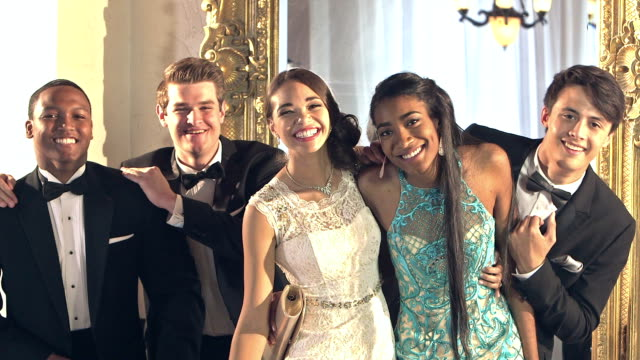 multi-ethnic friends at prom posing for photos - prom stock videos and b-roll footage