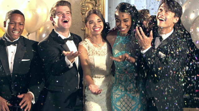 Multi-ethnic friends at prom, showered with confetti video