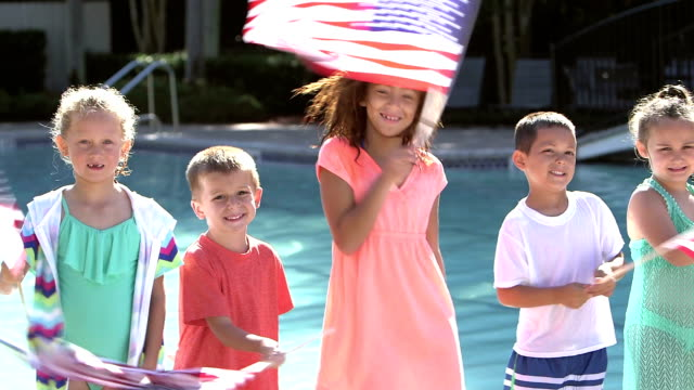 multi-ethnic group of children waving american flags - independence day stock videos & royalty-free footage