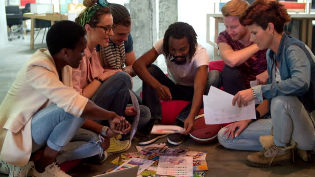 HD: Multi-ethnic group of designers joining hands together. video