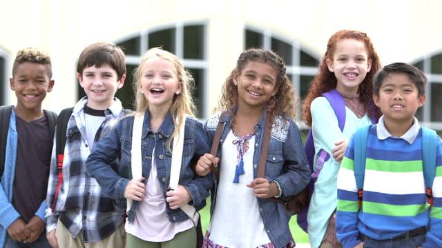 Multi-ethnic group of elementary school children in row video