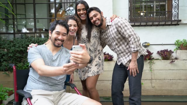 Multi-ethnic group of friends taking a selfie at home Always Together orthopedic equipment stock videos & royalty-free footage