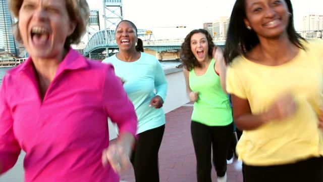 Multi-ethnic group of happy women running toward camera video