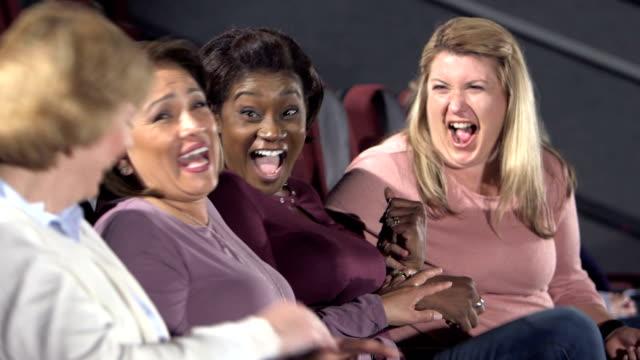 multi-ethnic group of mature women in movie theater - 40 49 lat filmów i materiałów b-roll