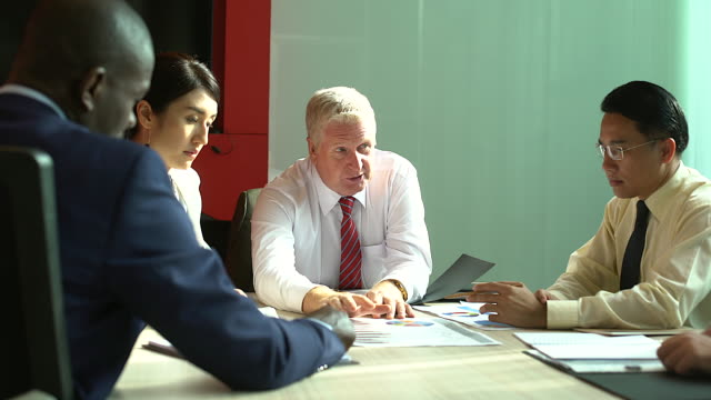 Multi-ethnic group of people attentive businesspeople in the meeting during brainstorming room.