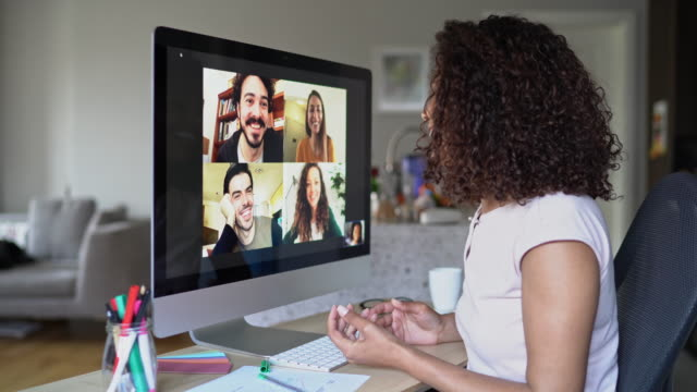 Multi-ethnic group of people in a video conference Group of people having a video call zoom call stock videos & royalty-free footage