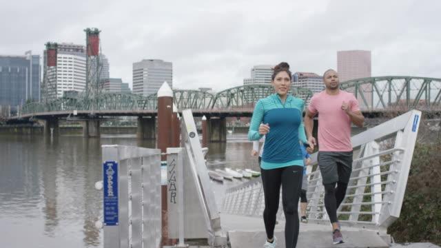 Multi-Ethnic Group of Runners Take a Break to Appreciate Cityscape video