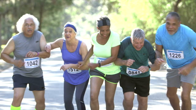 Multi-ethnic group of seniors running in race video