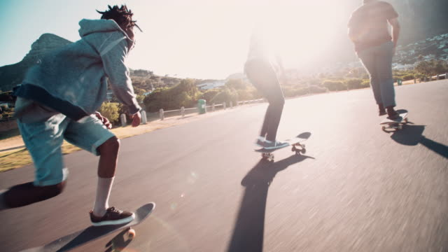 Multi-Ethnic Group of Skaters Skateboarding Down Street at Seasi video