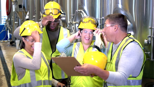 multi-ethnic group of workers in factory - occhiali protettivi video stock e b–roll