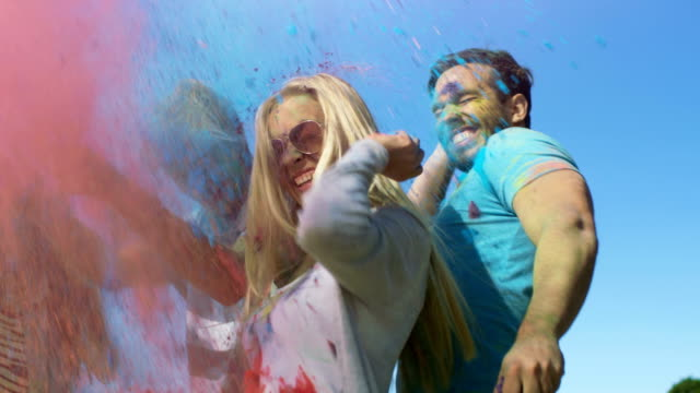Multi-Ethnic Group of Young People Throw Colorful Powder at Each other in Celebration of Holi Festival. They Have Enormous Fun on this Sunny Day. video