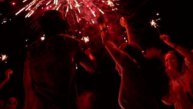 Multi-ethnic hipster friends celebrating fourth of July with fireworks display video