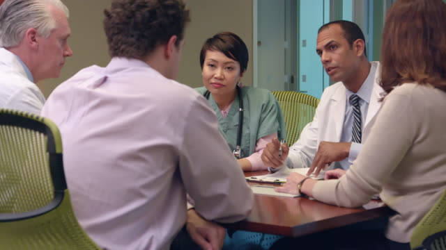 Multi-Ethnic Medical Professionals Meet in Office - MS video
