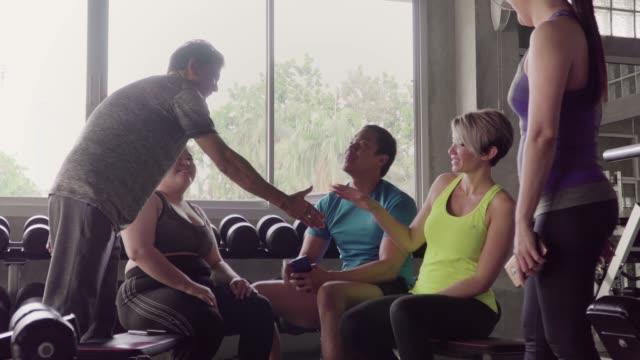 multi-ethnic people make friend in healthy community at fitness gym. - prendersi cura del corpo video stock e b–roll