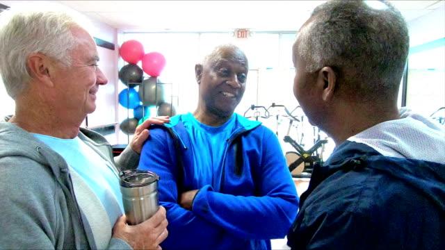 Multi-ethnic senior men talking at the gym video