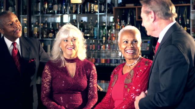 Multi-ethnic seniors at bar enjoying night out video