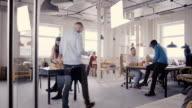 istock Multiethnic team working in modern trendy office. Happy young smiling creative millennials work in light coworking 4K 941753850