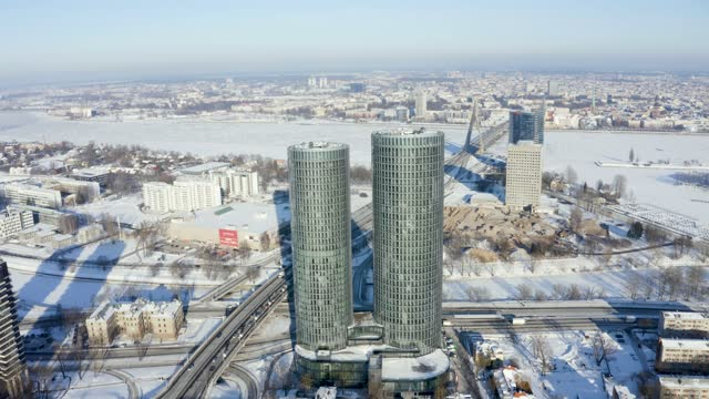 Multifunctional tower shape buildings, modern glass skyscrapers, residential Z-Towers. Aerial view during cold sunny winter day.