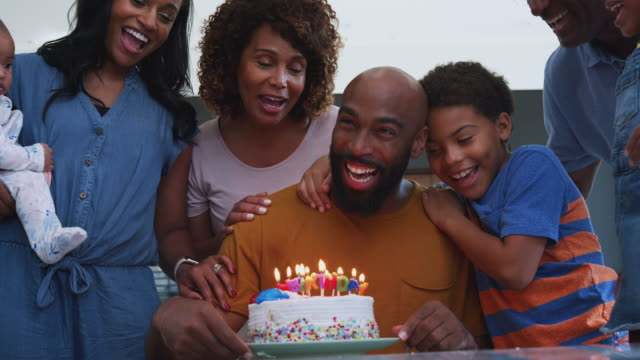 Multi-Generation African American Family Celebrating Fathers Birthday At Home Together Multi-generation African American family celebrating fathers birthday at home together - shot in slow motion black people stock videos & royalty-free footage