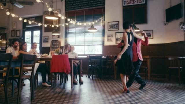multi-generation argentinian family enjoying tango show in the restaurant - argentyna filmów i materiałów b-roll