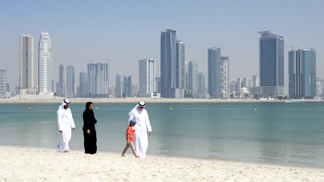 Multi-generation Emirati family on the beach video