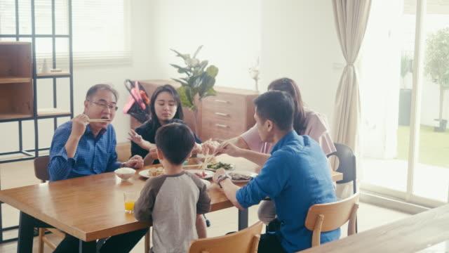 Multi-generation family enjoying dinner