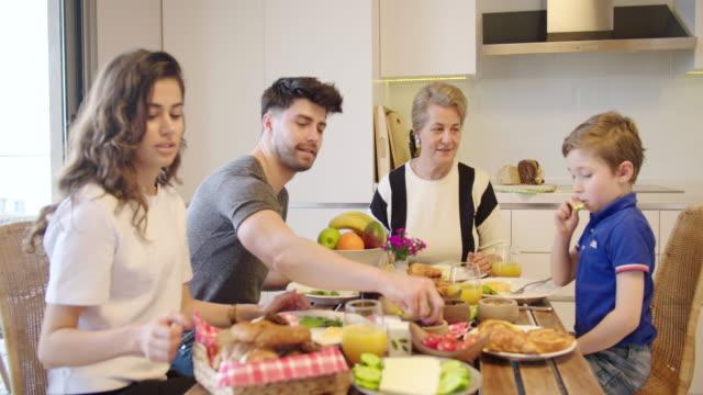 Multi-generation family having a breakfast video