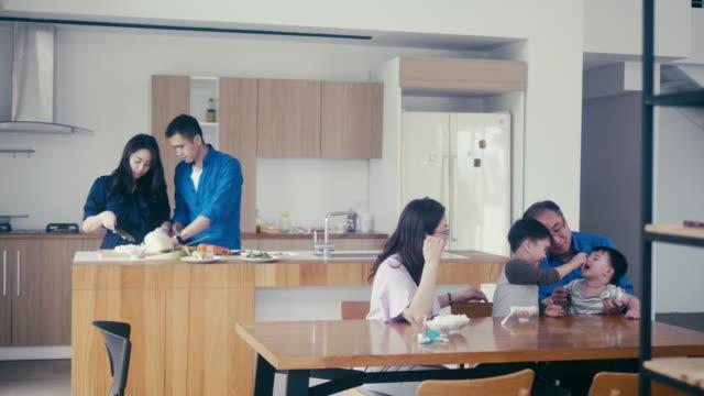 Multi-generation family preparing dinner