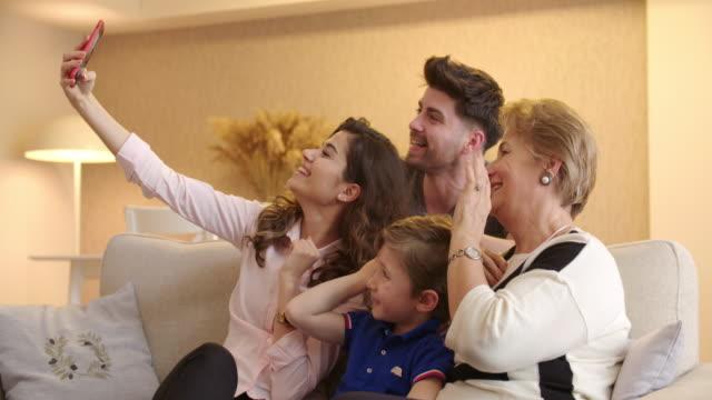 Multi-generation family taking a selfie video