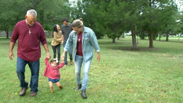 multi-generation hispanic family, walking baby - nonna e nipote camminare video stock e b–roll