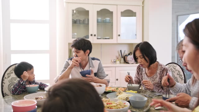 Multi-Generation Taiwanese Family Gathered for Lunch at Home