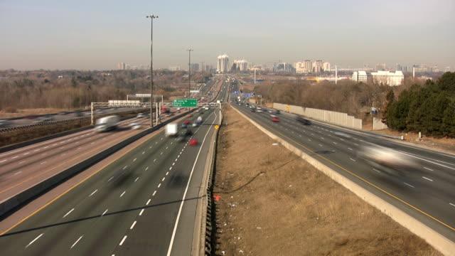 Multi-lane highway traffic. Timelapse. video