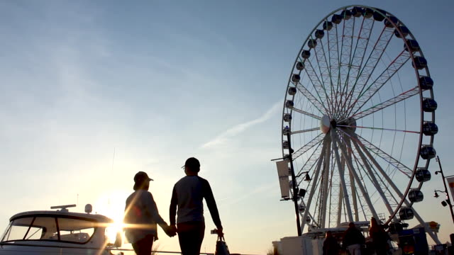 Multiple Couples and Families Walking Up To Ferris Wheel on Harbor at Sunset During A Beautiful Summer Night The Capital Wheel in Oxon Hill, Maryland at Sunset national landmark stock videos & royalty-free footage