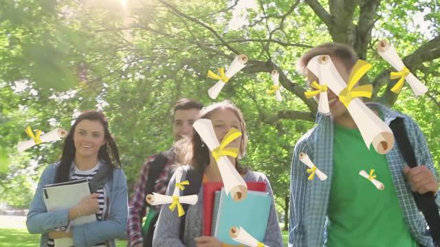 flera diplom ikoner faller mot grupp studenter som går i parken - moods vector boy bildbanksvideor och videomaterial från bakom kulisserna