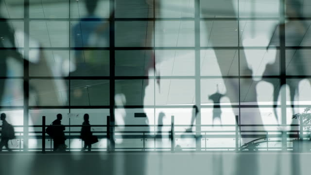 multiple exposure of people walking at airport - business travel stock videos and b-roll footage