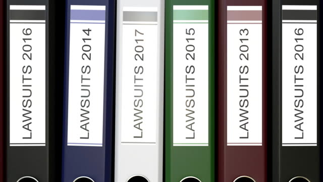 Multiple office folders with Lawsuits text labels different years video
