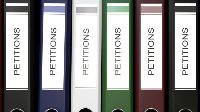 Multiple office folders with Petitions text labels video