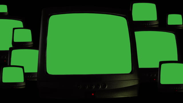 Multiple vintage televisions on black background, repeating pattern of many retro TVs with green screen chroma key and noise interference. TVs of 80s, old retro televisions with bad signal reception