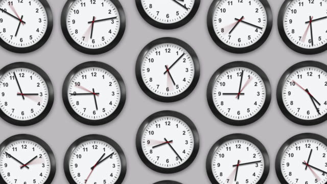 Multiple wall clocks in white background.