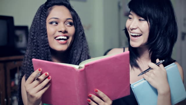 Multiracial happy girl students together with book. video