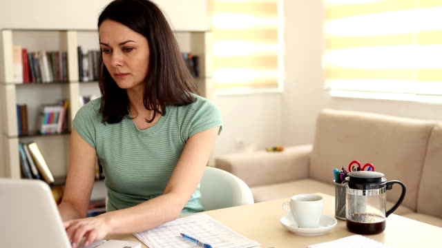 Multitasking mother working from home with child video