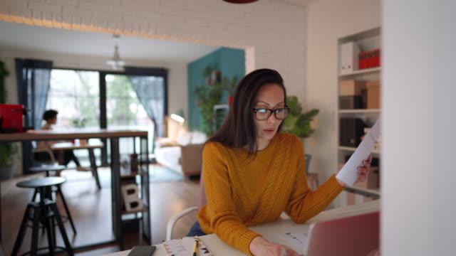 Multitasking of young female entrepreneur video