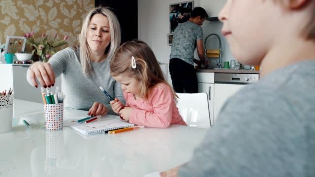 Mum and kids having fun while dad is washing the dishes Mum and kids having fun in the kitchen while dad is cleaning the dishes. washing dishes stock videos & royalty-free footage