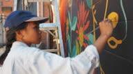 istock Mural artist at work 1006274050