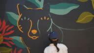istock Mural artist at work 1006386768