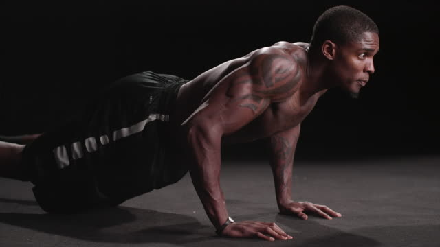 Muscular black man performing military push-ups Muscular black man performing military push-ups push ups stock videos & royalty-free footage