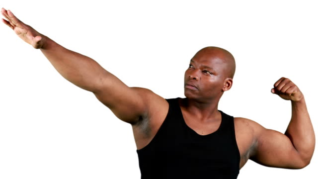 Muscular man gesturing in front of camera video