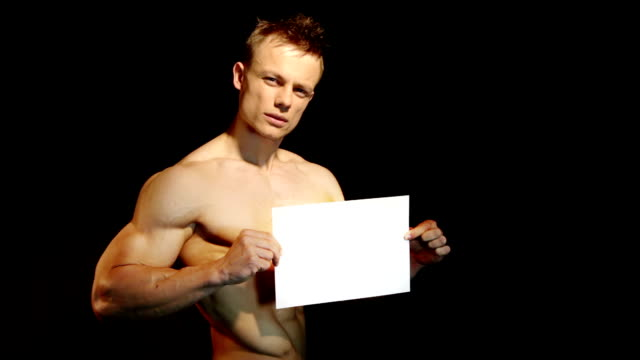 muscular man holding a white blank board video